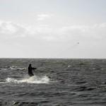 Kitesurfer auf dem Brett